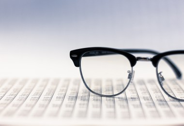 Glasses on financial reports selective focus at glasses.Analysis of stock market.